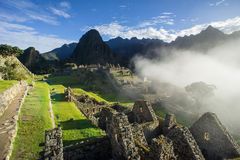 Sunrise Machu Picchu. With fog coming from the valley Royalty Free Stock Photography
