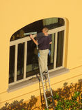 Sunrise Maintenance. A window washer at work in Palm Beach, Florida Stock Image