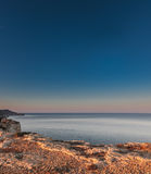 Sunrise at Majjistral Point. The view from Majjistral Park cliffs at sunrise royalty free stock images