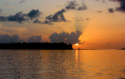 Sunrise in Maldives in cloudy sky Royalty Free Stock Photo