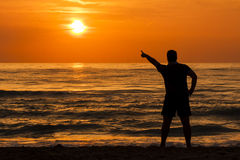 Sunrise  Man Silhouette Pointing Out Sun Stock Photo