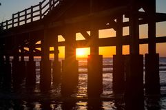 Sunrise on Mar del Tuyu pier stock photo