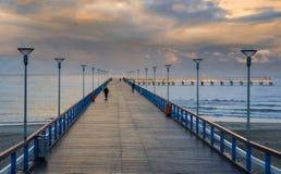 Sunrise at marine pier in Palanga Stock Photo