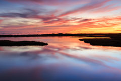 Sunrise Marsh Bodie Island Outer Banks North Carolina NC. Sunrise sky and water reflection over the marsh on Bodie Island, Cape Hatteras National Seashore, in Stock Images