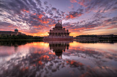 Sunrise at Masjid Putra, Putrajaya, Malaysia. Masjid Putra (Putra Mosque) is one of two main mosques in Putrajaya, Malaysia. This picture was taken in the Stock Photo