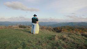 Sunrise on Max Patch Appalachian Mountains, Tennessee & North Carolina, young couple, woman in yellow dress, cowboy in. Sunrise on Max Patch Appalachian stock video footage