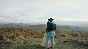 Sunrise on Max Patch Appalachian Mountains, Tennessee & North Carolina, young couple, woman in yellow dress, cowboy in. Sunrise on Max Patch Appalachian stock footage