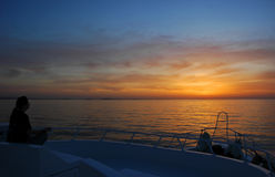 Sunrise meditation on the boat. Beautiful sunrise from the diving boat with sitting woman in meditation, Red Sea, Egypt Royalty Free Stock Photos
