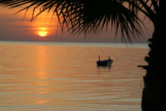 Sunrise on the Mediterranean. Boat at sea Royalty Free Stock Photography