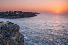 Sunrise at the Mediterranean Sea with the coast of Mallorca. Sunrise at the Mediterranean Sea with the coast of the Spanish island Mallorca, Europe Stock Photos