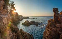 Sunrise on Mediterranean sea, Costa Brava, Spain. Sunrise on Mediterranean. Morning sunbeams through rocks on rocky seaside. Cliff on spanish coastline. Nature royalty free stock photos