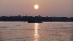 Sunrise,  mekong, cambodia. Ferry boat on Mekong River at sunrise, Cambodia stock video footage