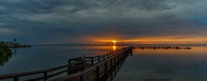 Sunrise at Merritt Island, Florida. Sunrise with clouds and dock at Banana River, Merritt Island, Florida, USA royalty free stock image