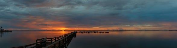 Sunrise at Merritt Island, Florida. Sunrise with clouds and dock at Banana River, Merritt Island, Florida, USA stock photography