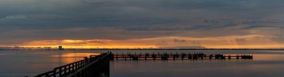 Sunrise at Merritt Island, Florida. Sunrise with clouds and dock at Banana River, Merritt Island, Florida, USA stock photos