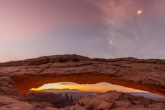 Sunrise at Mesa Arch With Moon royalty free stock photography