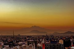 Sunrise of mexico city with mountains and mist royalty free stock images