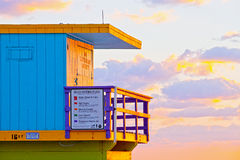 Sunrise in Miami Beach Florida, closeup with a colorful lifeguard house. In a typical Art Deco architecture, at sunrise with ocean and sky in the background Stock Photos