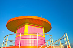 Sunrise in Miami Beach Florida, closeup with a colorful lifeguard house. In a typical Art Deco architecture, at sunrise with ocean and sky in the background Royalty Free Stock Image