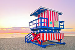 Sunrise in Miami Beach Florida, with a colorful American Flag lifeguard house Stock Photo