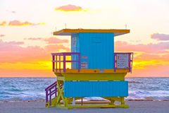 Sunrise in Miami Beach Florida, with a colorful lifeguard hous. E in a typical Art Deco architecture, at sunrise with ocean and sky in the background Royalty Free Stock Image