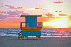 Sunrise in Miami Beach Florida, with a colorful lifeguard hous. E in a typical Art Deco architecture, at sunrise with ocean and sky in the background Royalty Free Stock Photography