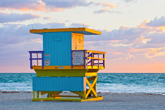 Sunrise in Miami Beach Florida, with a colorful lifeguard hous. E in a typical Art Deco architecture, at sunrise with ocean and sky in the background Stock Image
