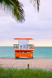 Sunrise in Miami Beach Florida, with a colorful lifeguard hous. E in a typical Art Deco architecture, at sunrise with ocean and sky in the background Stock Photography