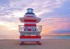 Sunrise in Miami Beach Florida, with a colorful lifeguard hous. E in a typical Art Deco architecture, at sunrise with ocean and sky in the background Royalty Free Stock Photo