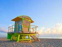 Sunrise in Miami Beach Florida, with a colorful lifeguard hous. E in a typical Art Deco architecture, at sunrise with ocean and sky in the background Stock Photos
