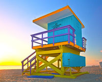 Sunrise in Miami Beach Florida, with a colorful lifeguard house. In a typical Art Deco architecture, at sunrise with ocean and sky in the background Royalty Free Stock Image
