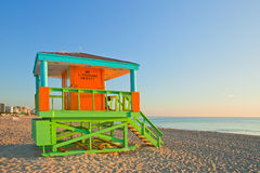Sunrise in Miami Beach Florida, with a colorful lifeguard house Royalty Free Stock Images