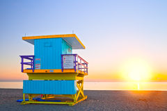 Sunrise in Miami Beach Florida, with a colorful lifeguard house. In a typical Art Deco architecture, at sunrise with ocean and sky in the background Stock Photos