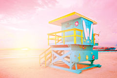 Sunrise in Miami Beach Florida, with a colorful lifeguard house. In a typical Art Deco architecture, at sunrise with ocean and sky in the background. Instagram Royalty Free Stock Images