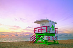 Sunrise in Miami Beach Florida, with a colorful lifeguard house Stock Photos