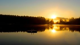 Sunrise Mirror Lake NY. Yellow sunrise reflection on Mirror Lake Royalty Free Stock Images