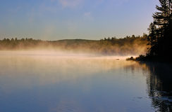 Sunrise and mist. In beautiful lake in Algonquin Park Royalty Free Stock Photography