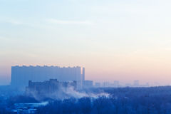 Sunrise mist and blue and pink sky over city Royalty Free Stock Photo