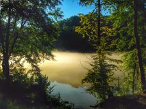Sunrise Mist. Cool Mountain River with rising fog Stock Image