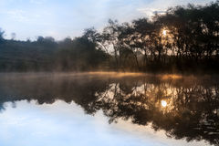 Sunrise, the  mist over the lake. Stock Photo