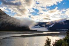 Sunrise mist over lake royalty free stock photography