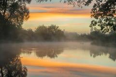 Sunrise mist over river stock photo