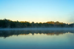 Sunrise with mist over water at Toddy Pond, Maine Royalty Free Stock Images