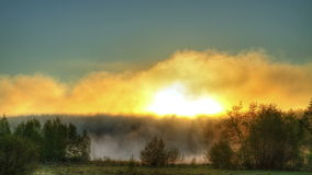 Sunrise through the mist. True HDR. Bright colors Stock Photo