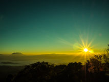 Sunrise. In mists on the mountain Royalty Free Stock Image