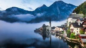 Sunrise in misty Hallstatt. Austria Royalty Free Stock Photography