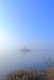 Sunrise on misty lake. Morning mist over the lake, birds flying over the water Stock Photography