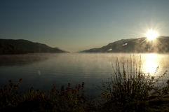 Sunrise on a misty lake - New Day - Peaceful and P. Sunrise in a clear day on a misty lake. A peaceful and pure new day that one wishes to begin with stock photos