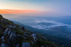 Sunrise Misty landscape. Landscape with fog view on mountain in Thailand Royalty Free Stock Photos