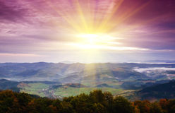 Sunrise in misty morning. And village view Royalty Free Stock Photos